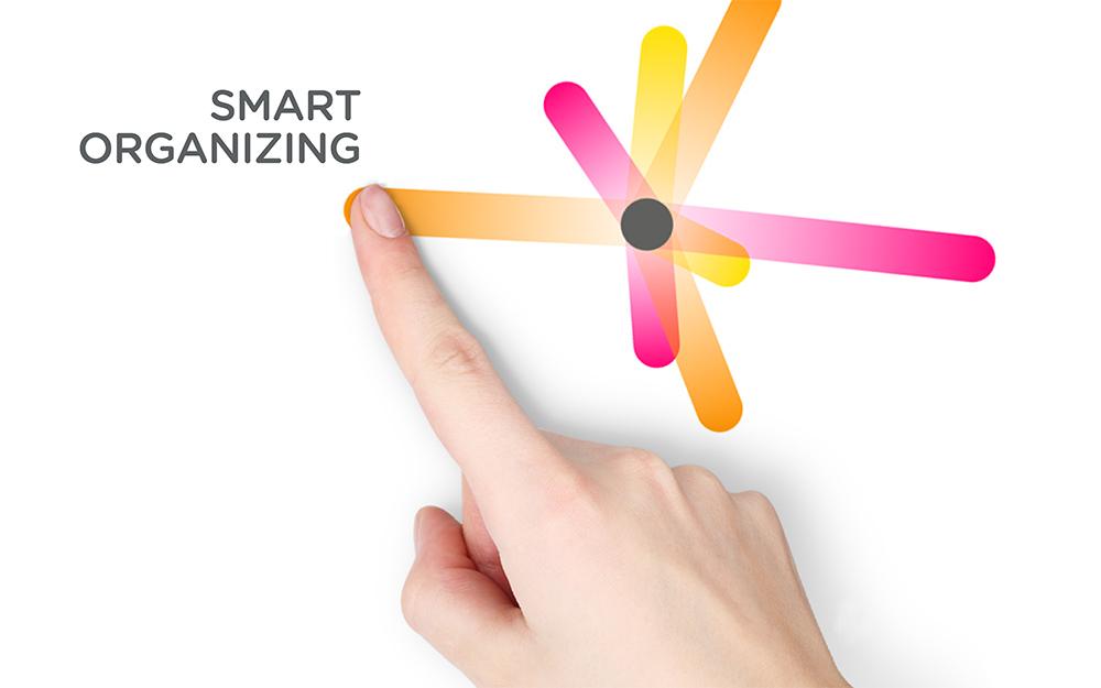 palec rysujący promień z logo firmy evenio