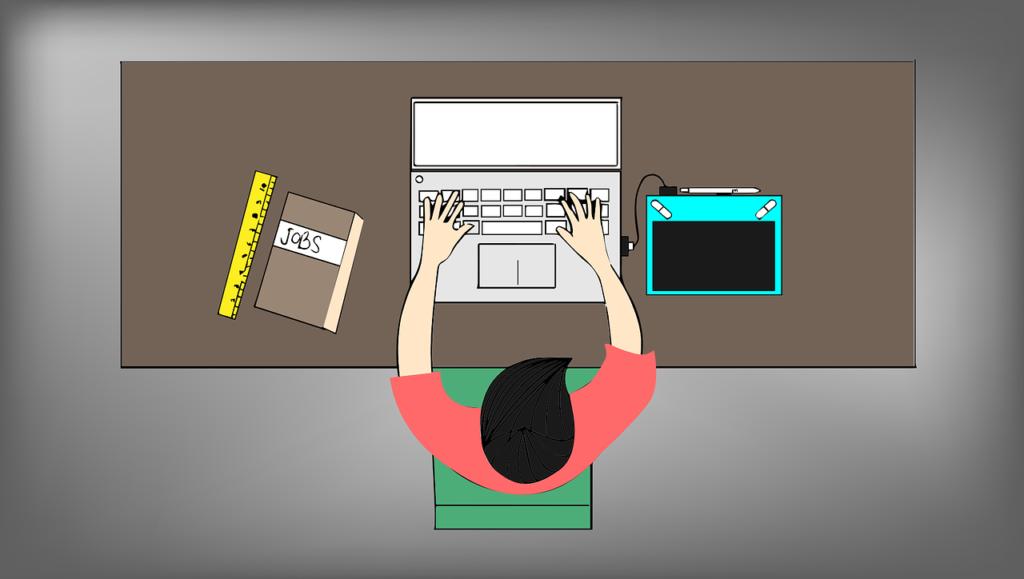 ilustracja designera pracującego przy komputerze